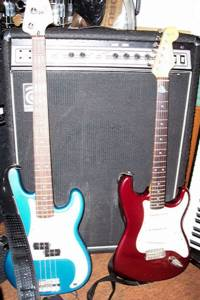 Fender Precision Bass and Stratocaster guitar with Ampeg amplifier