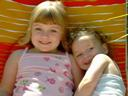 [Two daughters in a lawn chair, summer 2002]