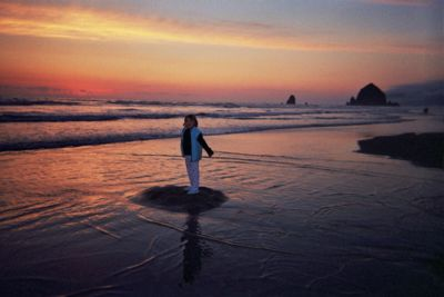 [Dancing daughter and Haystack Rock at sunset]