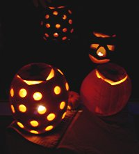 [Jack-o-lanterns at night]