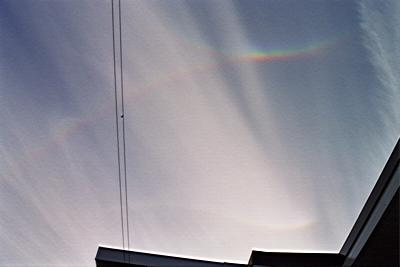 [Rainbows/sundogs in contact and bending in the sky]