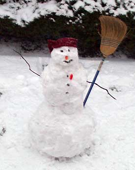 [Snowman with broom]